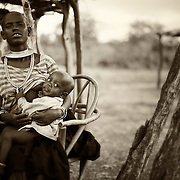 """""""Mother and Child""""                               Tanzania<br /> In the Savannas of Tanzania, on the edge of the Serengeti,  live the Datoga tribe; a primitive tribe that survives by herding cattle.   No matter where you go in this world the bond between a mother and a child is the same."""