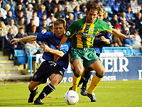 Photograph:Scott Heavey.<br />Gillingham v West Bromwich Albion. Nationwide Duvision one. 04/10/2003.<br />Andy Johnson (Right) holds off Gills player/manager Andy Hessenthaler.