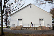 Mary Ethel Rhodes sweeps outside of on of the churches in the Dayton, Va. area. Families rotate their Sunday services around the area churches and take turns cleaning them.