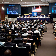 """Commission staffers present Staff Statement No. 15, """"Overview of the Enemy."""" The photo on the screens is of the World Trade Center bombing on February 26, 1993. The 9/11 Commission's 12th public hearing on """"The 9/11 Plot"""" and """"National Crisis Management"""" was held June 16-17, 2004, in Washington, DC."""