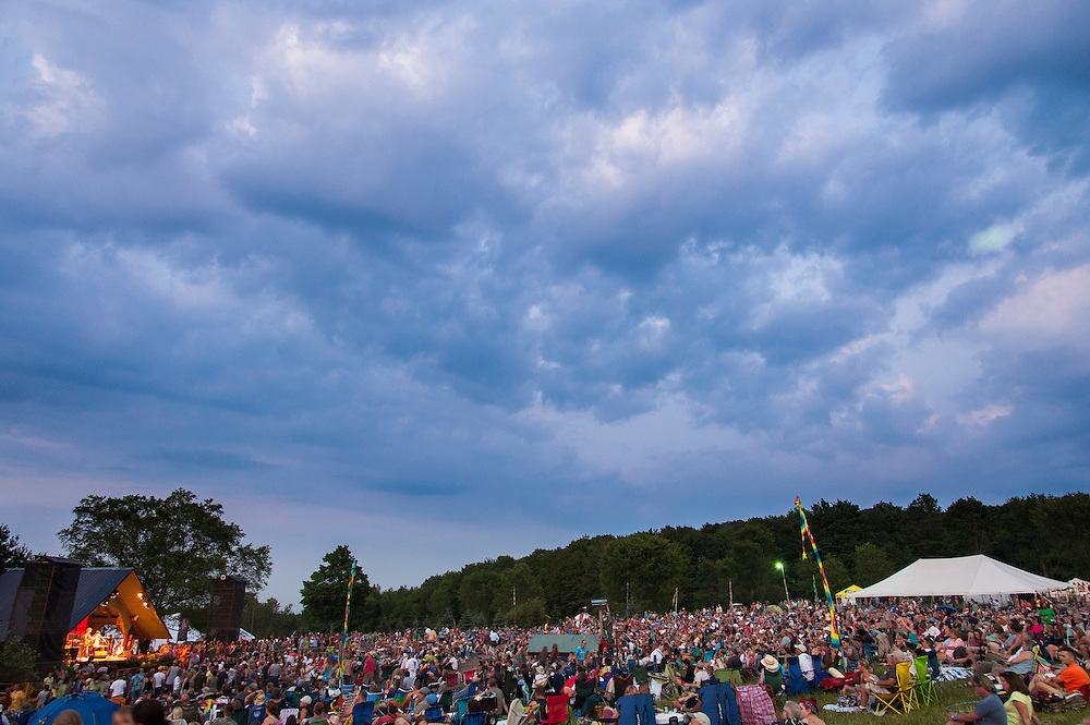 A crowd gathers for the main stage shows at Blissfest a Michigan music festival.