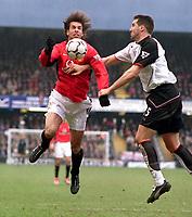 Ruud Van Nistelrooy (Utd) Ian Pearce (Fulham). Fulham v Manchester United. 28/2/04. Credit : Digitalsport/Andrew Cowie.