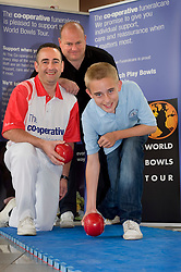 Co-op World Bowls Tour Launch at Ponds Forge Sheffield. .Top class bowler Simon Skelton with gives a master class to two generations of the Fowler family Dad Chris Fowler and His 12 year old son Danny watched by Co-op Funeral Care National Community Manager John Taylor  3 June 2010 .Images © Paul David Drabble.