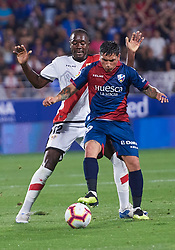 September 14, 2018 - Huesca, U.S. - HUESCA, SPAIN - SEPTEMBER 14: Chimy Avila, forward of SD Huesca competes for the ball with Imbula, midfielder of Rayo Vallecano de Madrid during the La Liga game between SD Huesca and Rayo Vallecano de Madrid  at Estadio El Alcoraz on September 14, 2018, in Huesca, Spain. (Photo by Carlos Sanchez Martinez/Icon Sportswire) (Credit Image: © Carlos Sanchez Martinez/Icon SMI via ZUMA Press)