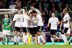 Germany's Sebastian Rudy (fourth from left) celebrates scoring his side's first goal of the game with his team-mates during the 2018 FIFA World Cup Qualifying, Group C match at Windsor Park, Belfast.