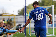 AFC Wimbledon midfielder Anthony Wordsworth (40) interacting with crowds and a fan during the EFL Sky Bet League 1 match between AFC Wimbledon and Rochdale at the Cherry Red Records Stadium, Kingston, England on 5 October 2019.