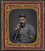 Stunning portraits from American Civil War  bright back to life in colour<br /> <br /> Unidentified Confederate soldier<br /> <br /> Unidentified soldier in Confederate sargeant's uniform and Company B hat with saber - between 1861 and 1865.<br /> <br /> ©Frédéric DurIiez/Exclusivepix Media
