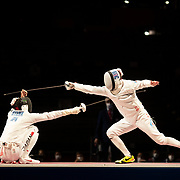 TOKYO, JAPAN - JULY 30:   Satoru Uyama of Japan (left) in action against Nikita Glazkov of ROC during the Japan V ROC gold medal match won by Japan 45-36  during the fencing epee team event for men at the Makuhari Messe at the Tokyo 2020 Summer Olympic Games on July 30, 2021 in Tokyo, Japan. (Photo by Tim Clayton/Corbis via Getty Images)