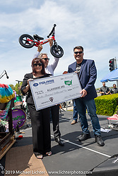 Steve Menneto, the president of motorcycles for Polaris Industries (including Indian) presented a check for $12,000 to the Ness family in Arlen's name to pay for Strider Balance bikes for kids in Arlen's Minnesota home town at the Arlen Ness Memorial - Celebration of Life at the Arlen Ness Motorcycles store. Dublin, CA, USA. Saturday, April 27, 2019. Photography ©2019 Michael Lichter.