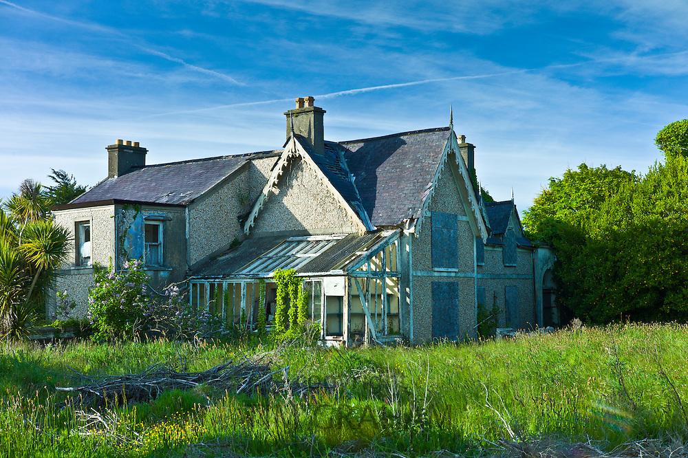 Abandoned derelict detached house awaiting renovation on Ocean Drive, Rosslare, Ireland