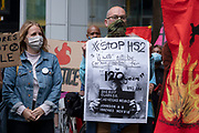 Anti HS2 placard on the Walk of Shame disruptive mach through the City of London by environmental group Extinction Rebellion on 4th September 2020 in London, United Kingdom. The walk visited various locations in the financial district, to protest against companies and institutions with historical links to the slave trade, or who finance or insure projects which are seen as ecologically unsound. The message by the group is that 'apologies and token attempts at diversity are not enough to address this legacy and present reality. Our demand is reparations and reparatory justice for those affected by colonial and neo-colonial exploitation'. Extinction Rebellion is a climate change group started in 2018 and has gained a huge following of people committed to peaceful protests. These protests are highlighting that the government is not doing enough to avoid catastrophic climate change and to demand the government take radical action to save the planet.