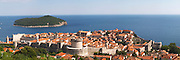 View from above of the old town with city walls and fort brick coloured rooftops roof tops Dubrovnik, old city. Dalmatian Coast, Croatia, Europe.