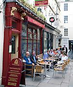 People sitting outside Coeur de Lion pub, Bath