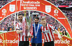 Lincoln City's Luke Waterfall, maanger Danny Cowley and Elliott Whitehouse celebrate with the trophy after the final whistle