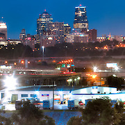 Panorama view of downtown Kansas City Missouri from KCK, with view of West Bottoms industrial area in foreground.