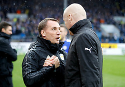 Burnley's manager Sean Dyche shakes hands with Leicester City manager Brendan Rodgers (left) ahead of kick-off during the Premier League match at Turf Moor, Burnley.