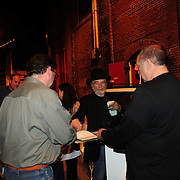Merle signs some autographs after the show