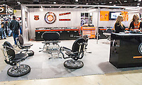 Furniture made from motorcycle parts in use at the Harley Davidson Insurance booth at the International Motorcycle Shows.