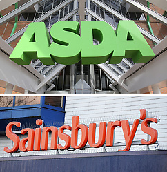Undated file photos of an ASDA and a Sainsbury's sign, as the two supermarket chains are in talks to merge.