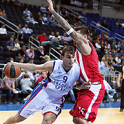 Anadolu Efes's Dario Saric (L) during their Gloria Cup Basketball Tournament match Anadolu Efes between Olympiacos at Ulker Sports Arena in istanbul Turkey on Tuesday 23 September 2014. Photo by Aykut AKICI/TURKPIX