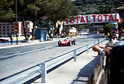 Formula One motor racing Monaco Grand Prix race 1961, Ferrari 156 F1 sharknose passing pits motion blur makes car number unclear