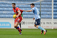 Coventry City defender Chris Stokes fouls Oldham Athletic striker Jake Cassidy during the Sky Bet League 1 match between Coventry City and Oldham Athletic at the Ricoh Arena, Coventry, England on 19 December 2015. Photo by Alan Franklin.