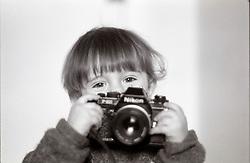 London, February 2004...A two years boy managing a SLR film camera