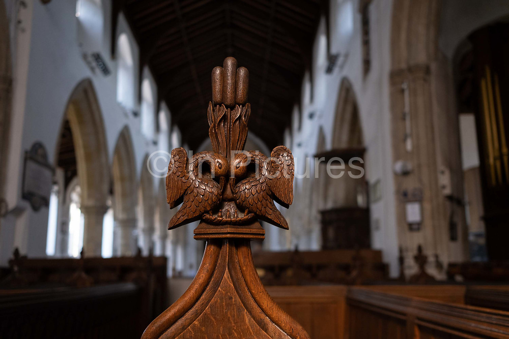Intricate wooden carvings on the end of pews in the Church of St. Michaels, on 10th August 2020, in Aylsham, Norfolk, England. The Church of St Michael and all Angels, Aylsham, Norfolk is a church of medieval origins that was built in the 14th century under the patronage of John of Gaunt, lord of the manor of Aylsham.