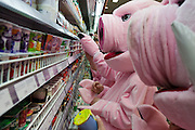 Moscow, Russia, 03/03/2011..Members of health campaign group Pigs Against check the sell-by dates and quality of food in a city centre supermarket while dressed in pig costumes.