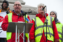 London, UK. 12th January, 2019. Erick Simon (l), 57, of the French 'gilets jaunes' addresses hundreds of protesters taking part in a 'Britain is Broken: General Election Now' demonstration organised by the People's Assembly Against Austerity. Organisers argued that the overriding objective of working people in the UK should be to remove the Conservative Government from power through a general election regardless of their vote in the EU referendum.