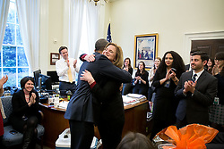 President Barack Obama hugs Communications Director Jennifer Palmieri during a farewell party on her last day at the White House, in Press Secretary Josh Earnest's West Wing office, March 20, 2015. (Official White House Photo by Pete Souza)<br /> <br /> This official White House photograph is being made available only for publication by news organizations and/or for personal use printing by the subject(s) of the photograph. The photograph may not be manipulated in any way and may not be used in commercial or political materials, advertisements, emails, products, promotions that in any way suggests approval or endorsement of the President, the First Family, or the White House.