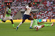 Nigeria William Troost-Ekong (5) tackling England Danny Welbeck (21) during the Friendly International match between England and Nigeria at Wembley Stadium, London, England on 2 June 2018. Picture by Matthew Redman.
