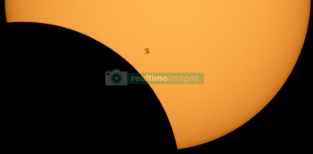 August 21, 2017 - Northern Cascades National Park, Washington, USA - The International Space Station, with a crew of six onboard, is seen in silhouette as it transits the Sun at roughly five miles per second during a partial solar eclipse, Monday, Aug. 21, 2017 from Ross Lake, Northern Cascades National Park, Washington.  Onboard as part of Expedition 52 are: NASA astronauts Peggy Whitson, Jack Fischer, and Randy Bresnik; Russian cosmonauts Fyodor Yurchikhin and Sergey Ryazanskiy; and ESA (European Space Agency) astronaut Paolo Nespoli. A total solar eclipse swept across a narrow portion of the contiguous United States from Lincoln Beach, Oregon to Charleston, South Carolina. A partial solar eclipse was visible across the entire North American continent along with parts of South America, Africa, and Europe.  .Mandatory Credit: Bill Ingalls / NASA via CNP (Credit Image: © Bill Ingalls/CNP via ZUMA Wire)