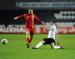 Joe Allen (Liverpool) of Wales  battles for the ball with Zlatko Junuzovic (Werder Bremen) of Austria  - Photo mandatory by-line: Joe Meredith/JMP - Tel: Mobile: 07966 386802 06/02/2013 - SPORT - FOOTBALL - Liberty Stadium - Swansea  -  Wales V Austria - International Friendly