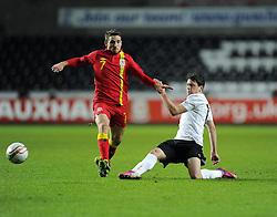 Joe Allen (Liverpool) of Wales  battles for the ball with Zlatko Junuzovic (Werder Bremen) of Austria  - Photo mandatory by-line: Joe Meredith/JMP - Tel: Mobile: 07966 386802 06/02/2013 - SPORT - FOOTBALL - Liberty Stadium - Swansea  -  Wales V Austria - International Friendly