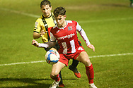 Ben Seymour of Exeter shields the ball from Josh Falkingham og Harrogate  during the EFL Sky Bet League 2 match between Harrogate Town and Exeter City at the EnviroVent Stadium, Harrogate, United Kingdom on 19 January 2021.