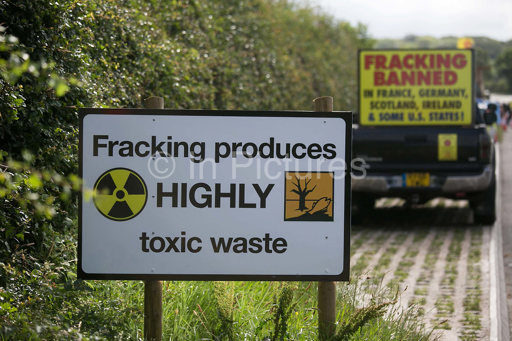 A sign put up by anti-fracking activists near the entrance to  Quadrillas drill site in New Preston Road, July 01 2017, Lancashire, United Kingdom. Fracking produces highly toxic waste.The blockade is a repsonse to the emmidiate drilling for shale gas, fracking, by the fracking company Quadrilla and part of an ongoing struggle where makeshift towers and makeshift camps have sprung up outside the premisses. Lancashire voted against permitting fracking but was over ruled by the conservative central Government. All the activists have been active in the struggle against fracking for years but this is their first direct action of peacefull protesting. Fracking is a highly contested way of extracting gas, it is risky to extract and damaging to the environment and is banned in parts of Europe . Lancashire has in the past experienced earth quakes blamed on fracking.