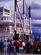 Visitors touring the S.S. Klondike II, a sternwheeler built in 1937 to haul cargo, passengers and ore on the Yukon River, S.S. Klondike National Historic Site, Whitehorse, Yukon Territory, Canada.