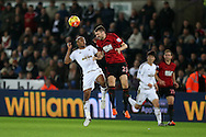 Andre Ayew of Swansea city (l) challenges Gareth McAuley of West Bromwich Albion. Barclays Premier league match, Swansea city v West Bromwich Albion at the Liberty Stadium in Swansea, South Wales  on Boxing Day Saturday 26th December 2015.<br /> pic by  Andrew Orchard, Andrew Orchard sports photography.