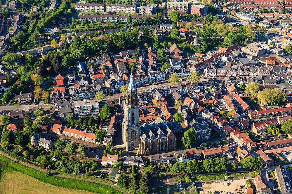 Nederland, Utrecht, Rhenen, 27-05-2013; het centrum van de stad is tijdens de Tweede wereldoorlog grotendeels verwoest (Slag bij de Grebbenberg, mei 1940), herbouw van de dorpskern werd reeds gestart in de jaren veertig (jaren '40). Boven in beeld de Neder-rijn.<br /> In het centrum de Cunerakerk en Cuneratoren. <br /> Klassiek voorbeeld van wederopbouw, de oorspronkelijke stedenbouwkundige structuur is gehandhaafd. <br /> Center of Rhenen was destroyed in May 1940 ( World War II), and restored with classic and exemplary example of reconstruction, while the original urban structure has been maintained.<br /> luchtfoto (toeslag op standard tarieven)<br /> aerial photo (additional fee required)<br /> copyright foto/photo Siebe Swart