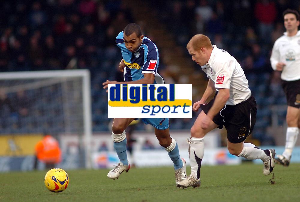 Photo: Kevin Poolman.<br />Wycombe Wanderers v Hereford United. Coca Cola League 2. 01/01/2007. Wycombe's Kevin Betsy (left) and Simon Travis of Hereford both go after the ball.
