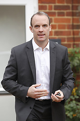 © Licensed to London News Pictures. 15/11/2018. London, UK. Dominic Raab is seen leaving his house after he resigned as Brexit secretary. Prime Minister Theresa May has made a statement to MPs in Parliament on the EU withdrawal agreement today after cabinet agreed on the proposal. Photo credit: Peter Macdiarmid/LNP