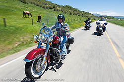 Dana Smith of Parker, CO and Douglas County HOG Chapter member on her 2008 Softail Deluxe riding the 20 Mile Road in Steamboat Springs during the Rocky Mountain Regional HOG Rally, Colorado, USA. Saturday June 10, 2017. Photography ©2017 Michael Lichter.