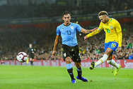 Uruguay defender Matias Vecino (13) and Brazil forward Neymar Jr (10) during the Friendly International match between Brazil and Uruguay at the Emirates Stadium, London, England on 16 November 2018.