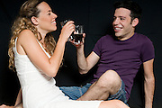 A romantic young couple in their 20s on a black background Model Releases available