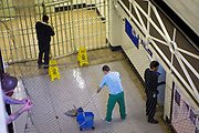 A prisoner on cleaning duties. HMP Wandsworth, London, United Kingdom.
