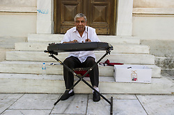 Despite the financial problems, impending election and the influx of refugees the capital of Greece is still operating as it always has. Visitors are hard press to see any difference in a holiday in Greece this year comoared with any other year. Prices may be a little higher but it is a small price to pay for the welcome the Greeks are willing to give to all who are in their country. Zither players still line the streets to the Acropolis<br /> <br /> © Ger Harley/ StockPix.eu