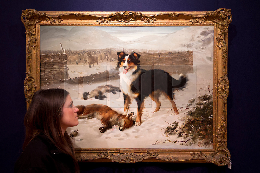 © Licensed to London News Pictures. 15/01/2013. London, UK. A Bonhams employee views a snowy scene in the form of a watercolour by British artist Walter Hunt entitled 'Retribution' (1884) (Est. GB£7,000-10,000), at an auction press view held today (15/01/13) at Bonhams in New Oxford Street, London. The auction, '19th Century Paintings, Drawings and Watercolours', will take place on the 23rd of January at Bonhams' 101 New Bond Street Premisses. Photo credit: Matt Cetti-Roberts/LNP