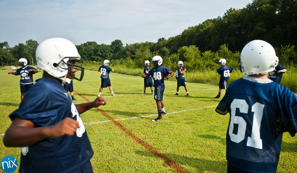 Hickory Ridge's Demetrey Benton, center, leads his teammates through stretching drills at football practice Monday, July 30 at Hickory Ridge High School in Harrisburg. (photo by James Nix)