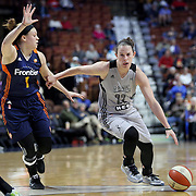 UNCASVILLE, CONNECTICUT- MAY 05:  Samantha Logic #22, (right), of the San Antonio Stars drives past Rachel Banham #1 of the Connecticut Sun during the San Antonio Stars Vs Connecticut Sun preseason WNBA game at Mohegan Sun Arena on May 05, 2016 in Uncasville, Connecticut. (Photo by Tim Clayton/Corbis via Getty Images)